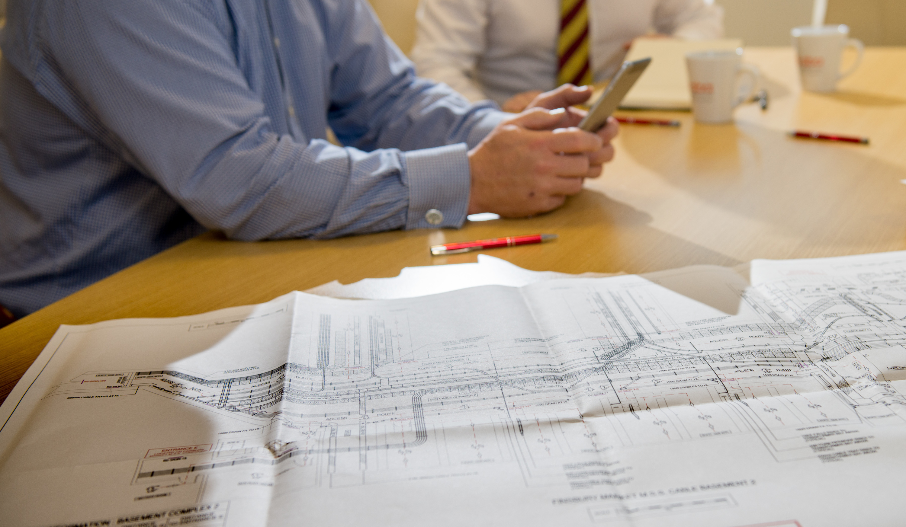 Technical drawings on desk ABA technical
