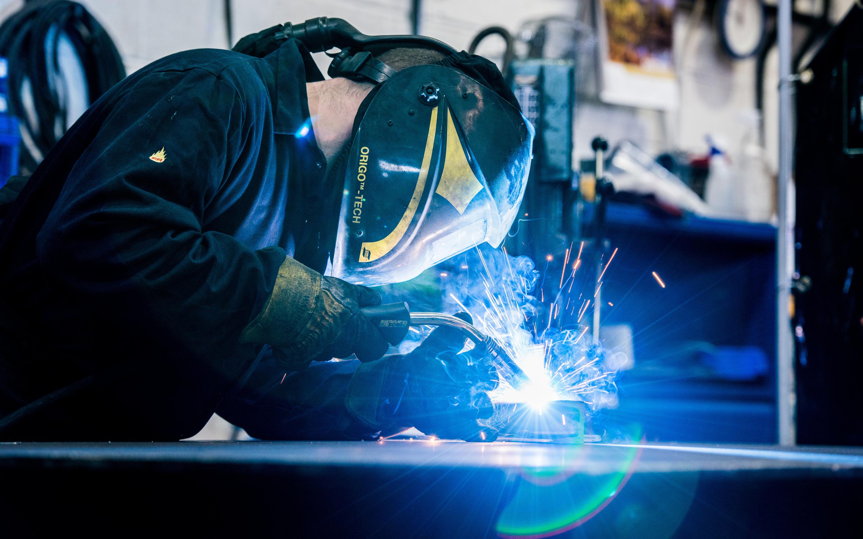 Apex lifts, man welding